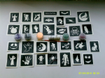 Halloween themed glitter tattoo set including 30 stencils + 5 glitter colors + glue    Great for fund raising  ghost  skeleton  bat  monster